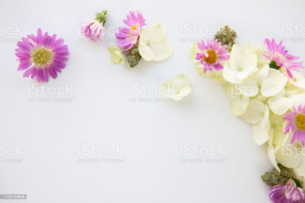 White Hydrangea and Purple Daisy Cannabis Floral Bouquet with Marijuana Bud - Top Down Right stock photo