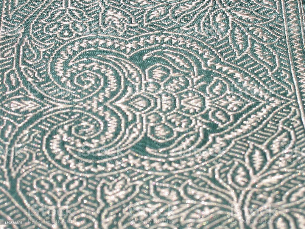 white indian pattern on green sari border (close-up) royalty-free stock photo