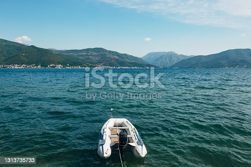istock White inflatable motor boat on the background of the Kotor bay and green mountains 1313735733