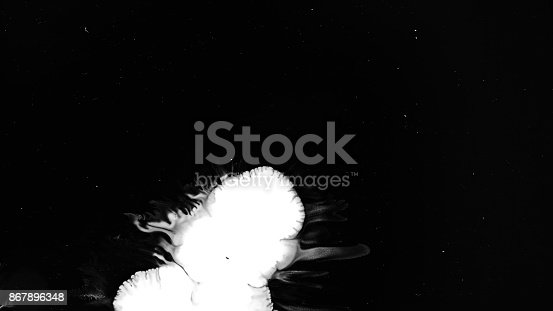 istock White Ink Drops Over Wet Black Screen Background 867896348