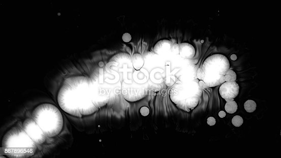 istock White Ink Drops Over Wet Black Screen Background 867896546