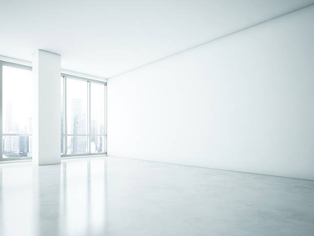 ... White interior with big blank wall stock photo ...