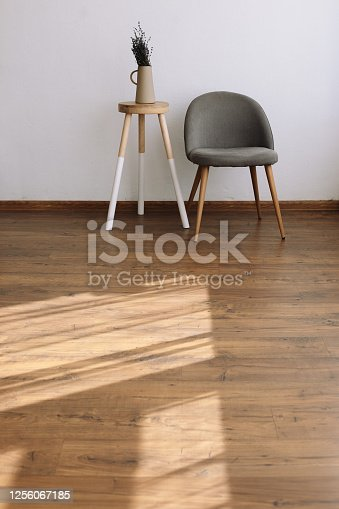 994217090 istock photo White interior with kale gray chair, rug and small table 1256067185