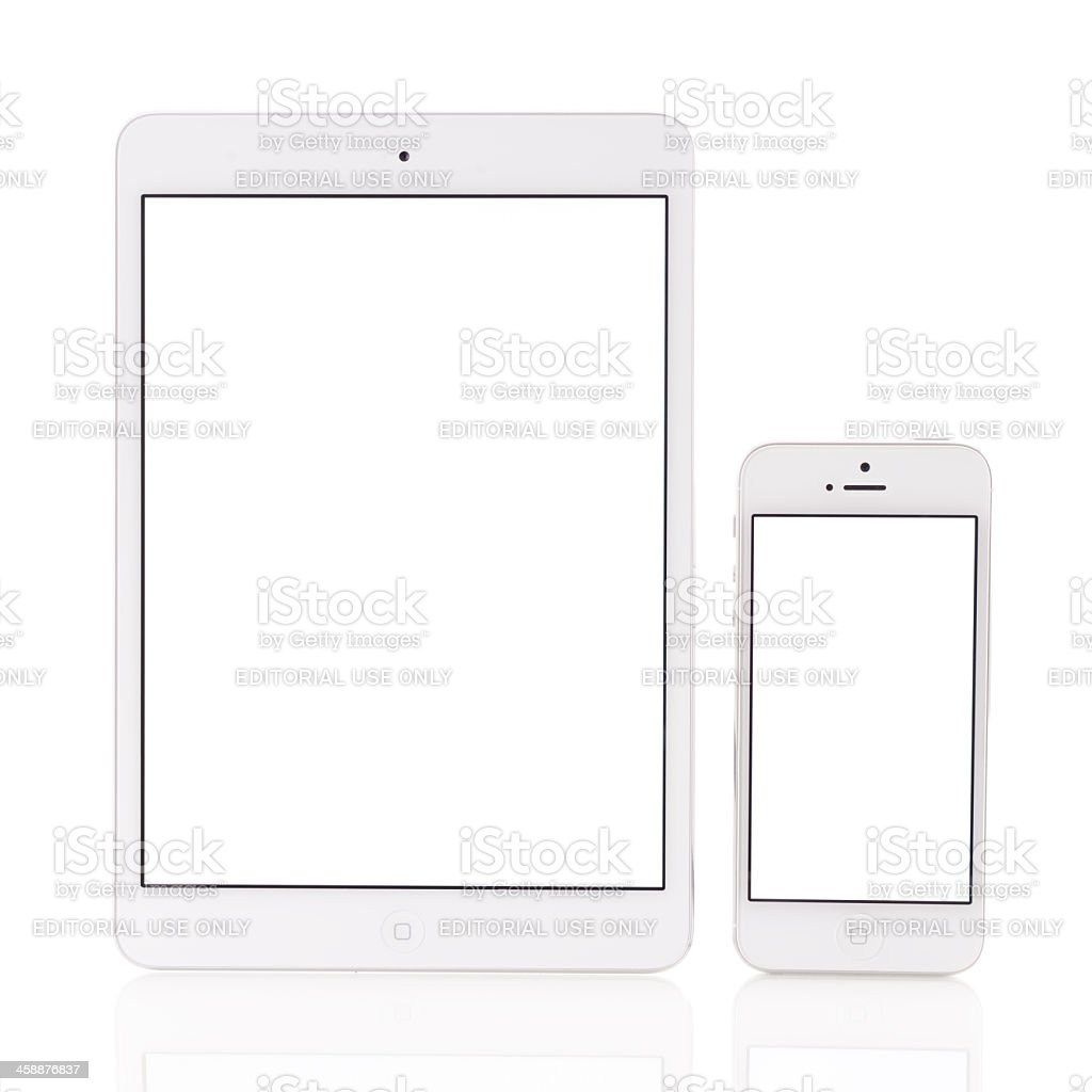 White iPad Mini and iPhone 5 stock photo