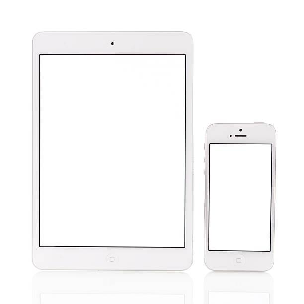 White iPad Mini and iPhone 5 stock photo