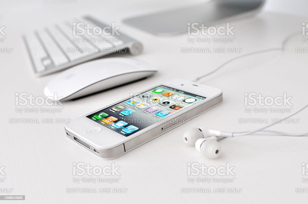White iPhone 4 with headphones royalty-free stock photo