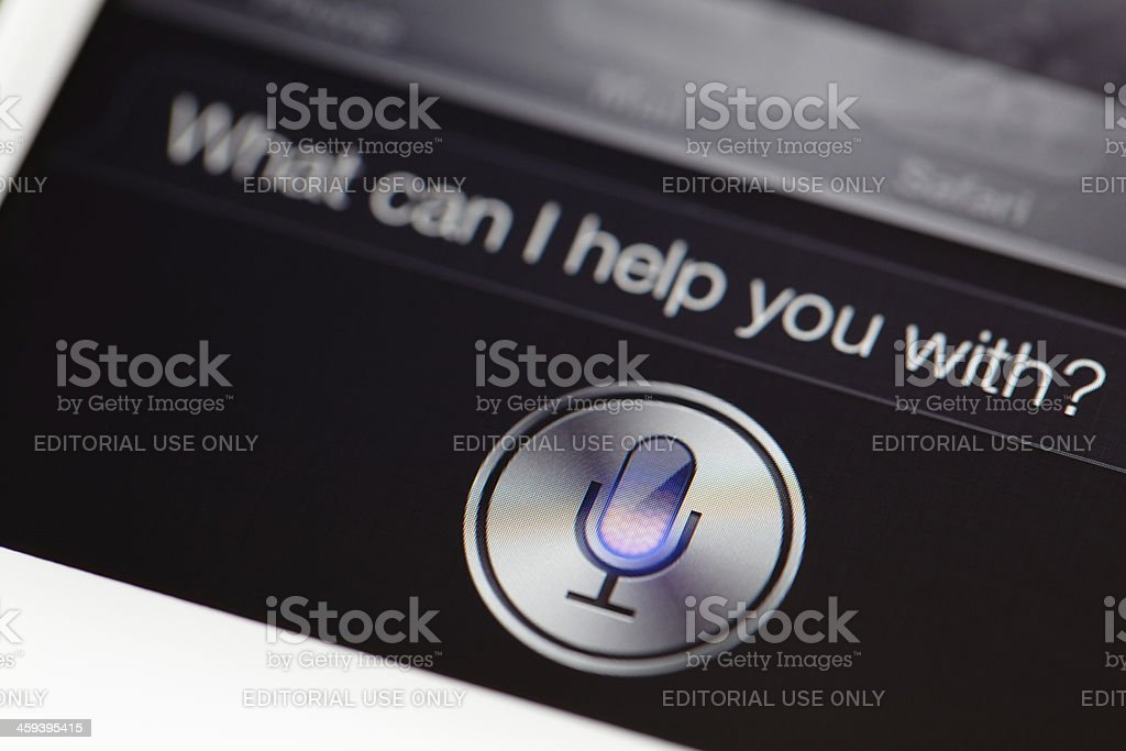 White iphone 4s using siri royalty-free stock photo