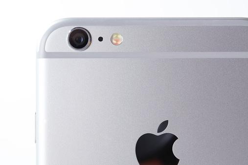 White iPhone 6 plus on white background back part camera