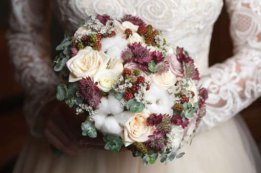 istock White, ivory and dusty pink bridal bouquet 612619318
