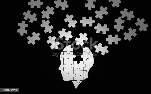 istock White jigsaw puzzle as a human brain on black. Concept for Alzheimer's disease. 3d illustration 953433208