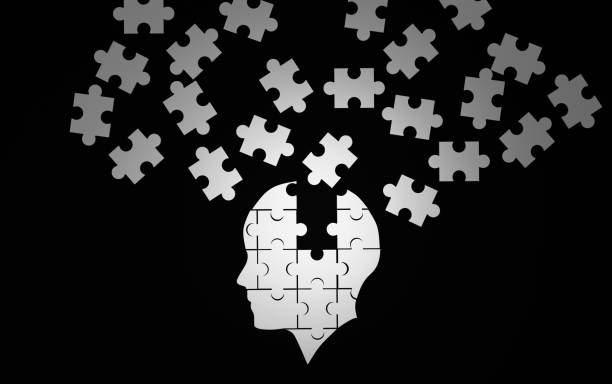 White jigsaw puzzle as a human brain on black. Concept for Alzheimer's disease. 3d illustration stock photo