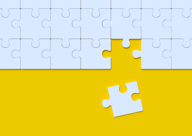 white jigsaw puzzle on yellow background with copy space - lost стоковые фото и изображения