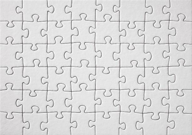 white jigsaw puzzle - jigsaw puzzle stock photos and pictures