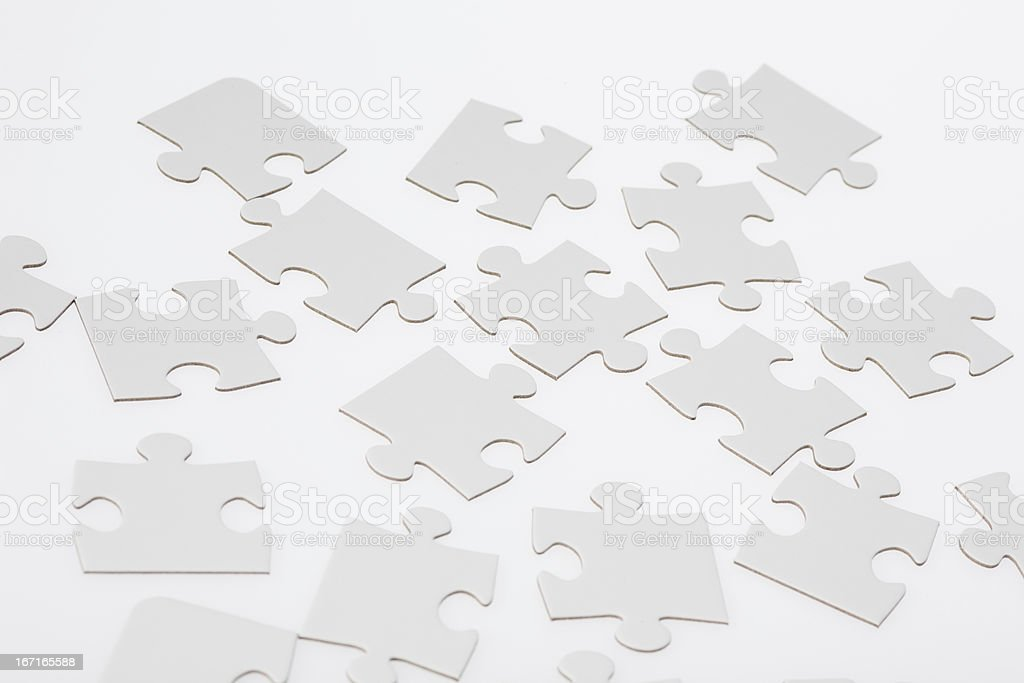 White Jigsaw Puzzle Pieces royalty-free stock photo