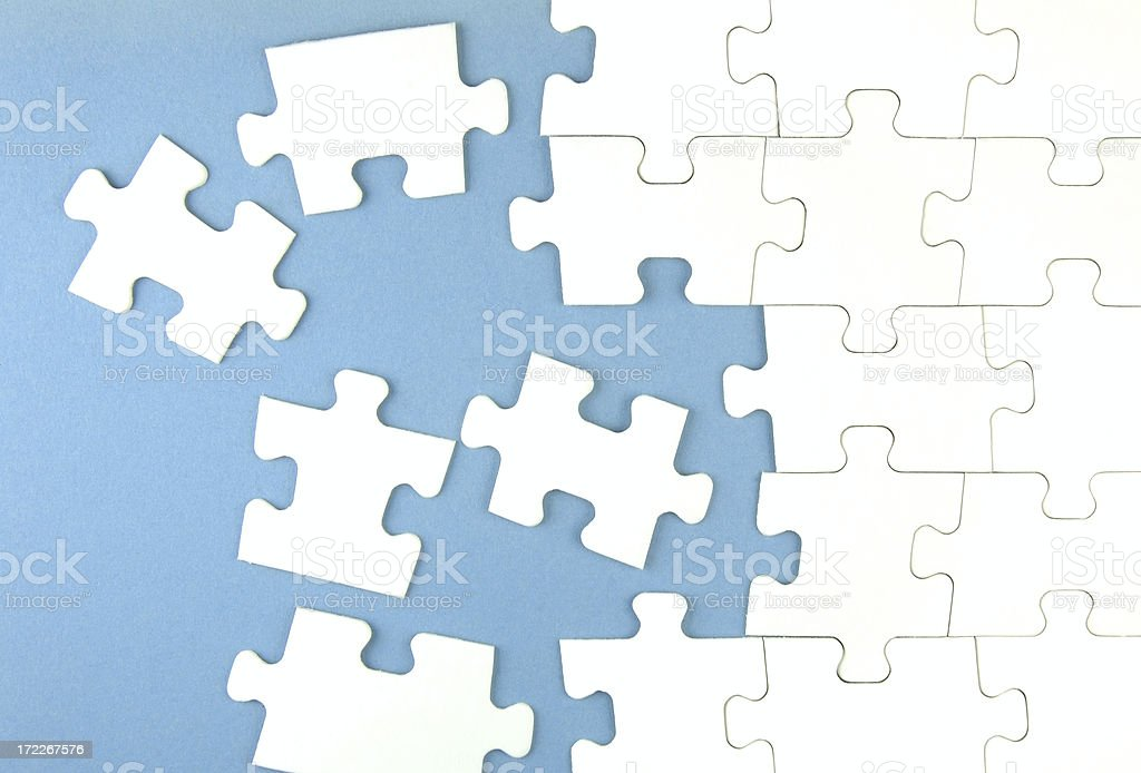 White jigsaw puzzles against a soft blue background royalty-free stock photo