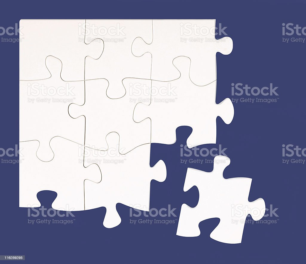 White jigsaw with blue background royalty-free stock photo