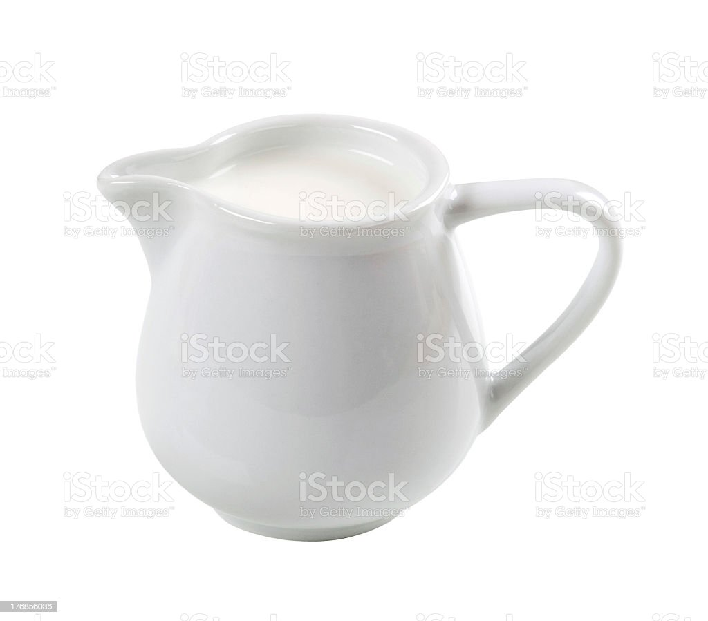 White jug filled with fresh milk stock photo