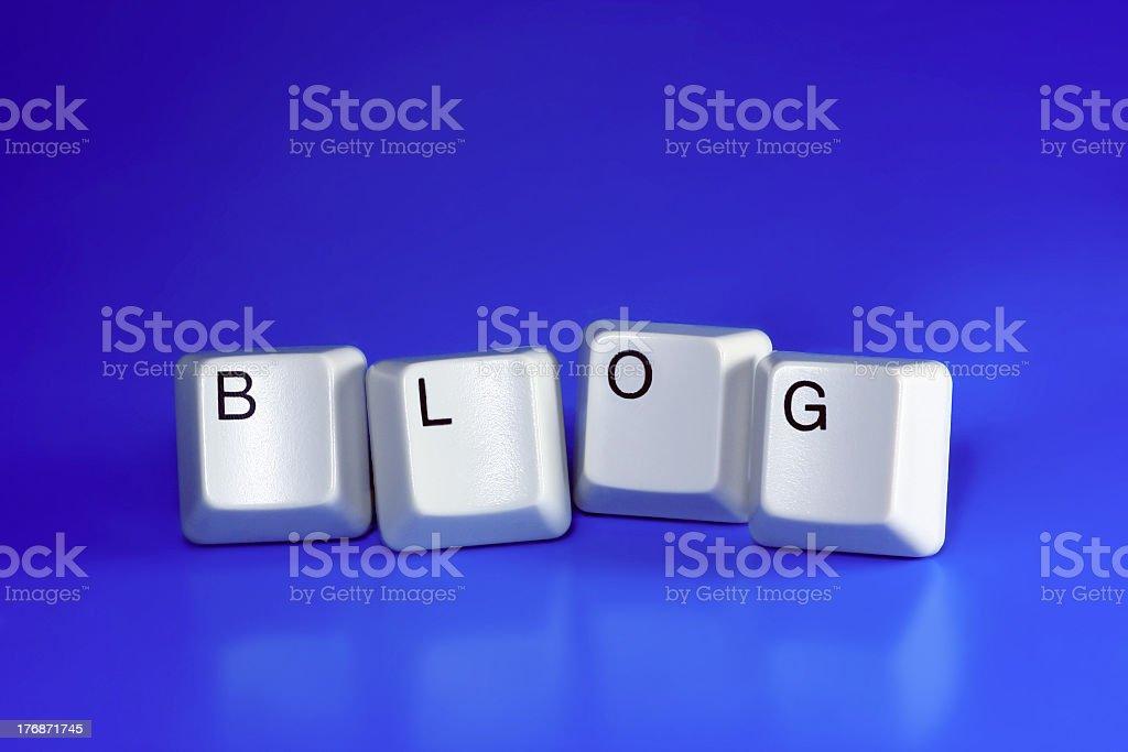 White keyboard keys on blue background spelling blog royalty-free stock photo
