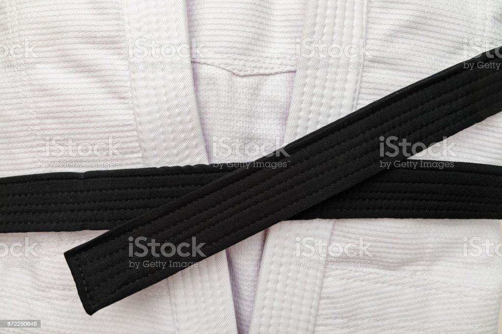 White kimono with black belt stock photo