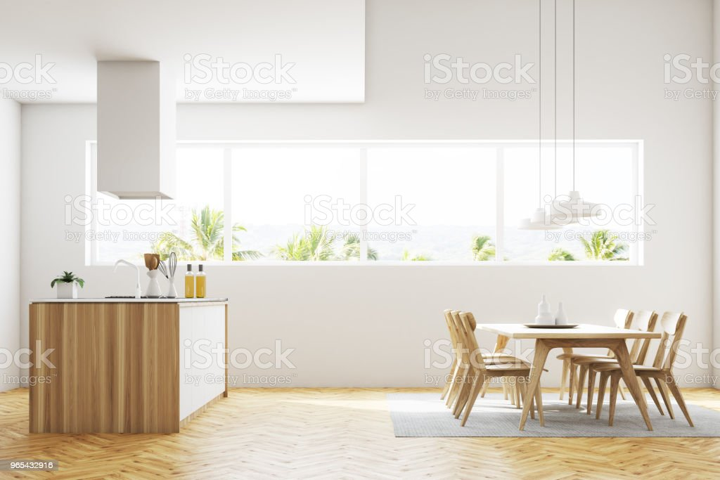 White kitchen and dining room interior side view royalty-free stock photo