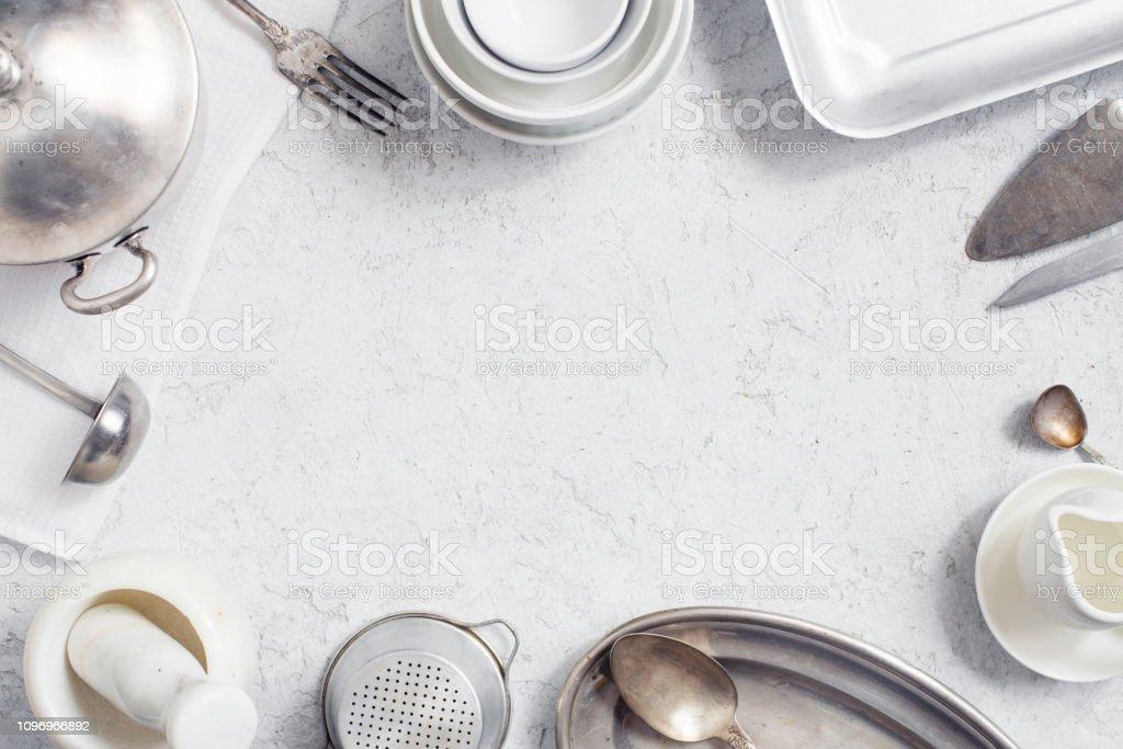 White Kitchen Background Decorated With Vintage Kitchen Utensils