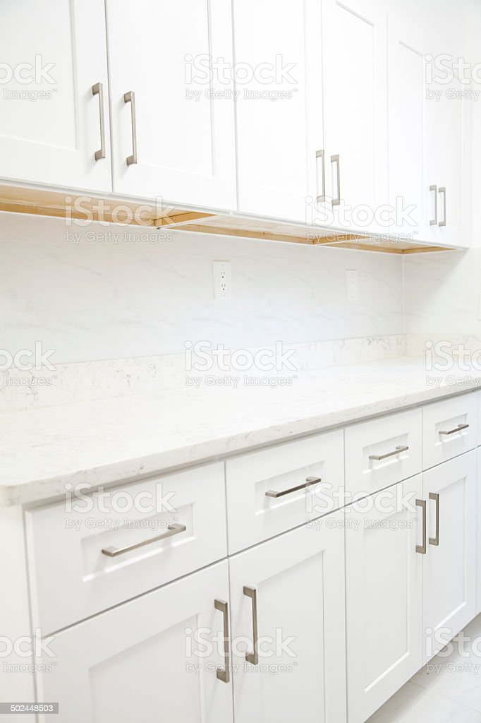 White kitchen cabinet stock photo
