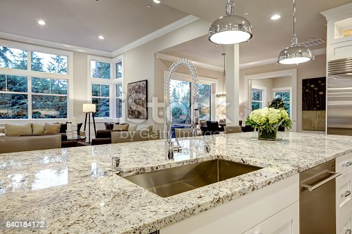 istock White kitchen design in new luxurious home 640184172