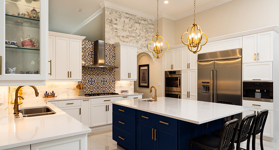 Beautiful luxury estate home kitchen with white cabinets.