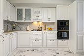istock White kitchen in classic style, front view 1291426230
