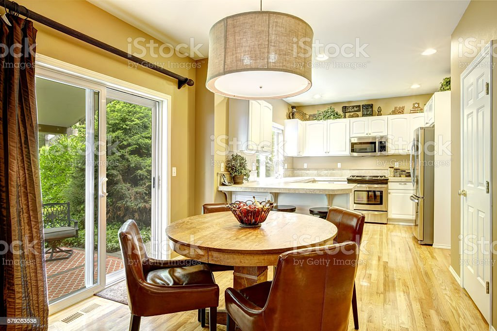 White kitchen room interior with dining area stock photo