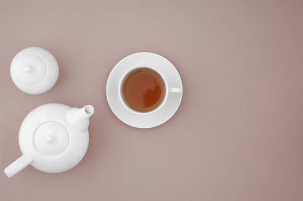 white kitchen utensils white ceramic teapot with сup on brown background, top view teapot stock pictures, royalty-free photos & images