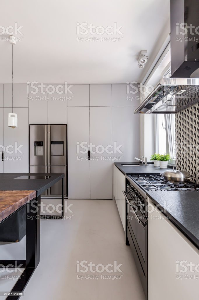 White kitchen with fitted cabinets stock photo