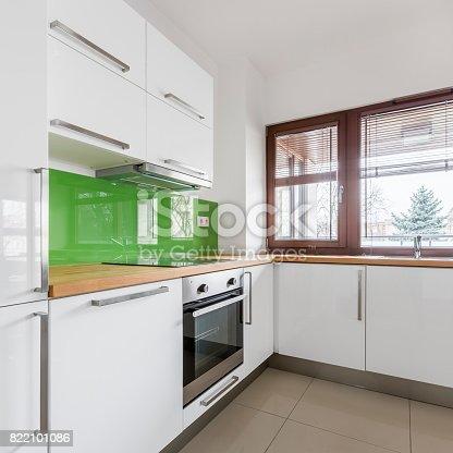 istock White kitchen with modern cupboards 822101086