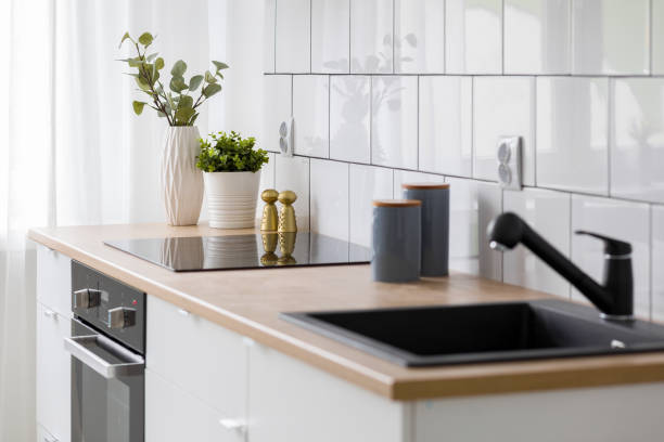 White kitchen with wooden countertop stock photo