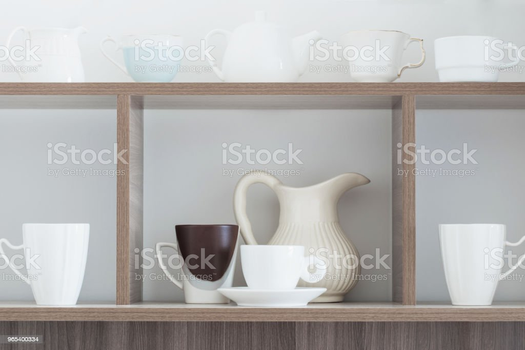 white kitchenware on wooden shelf royalty-free stock photo