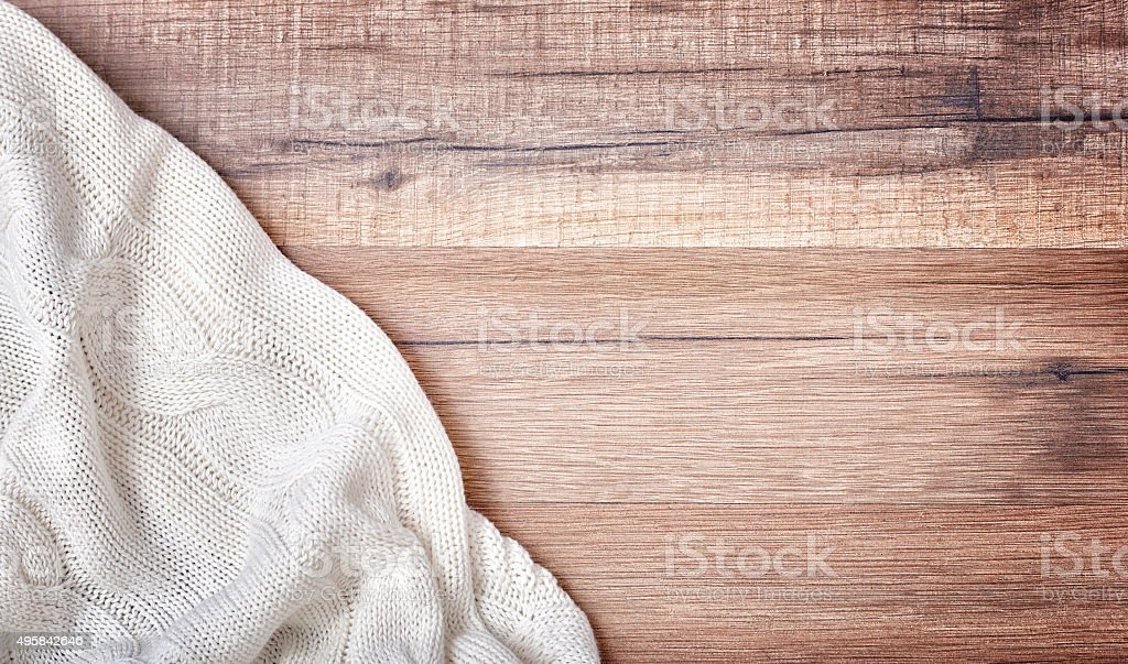 white knitted blanket stock photo