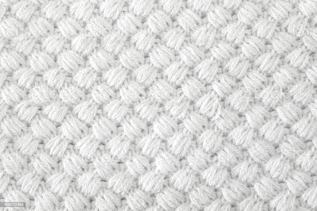 fdc646fd9faad9 White knitted fabric made of heathered yarn textured background  royalty-free stock photo