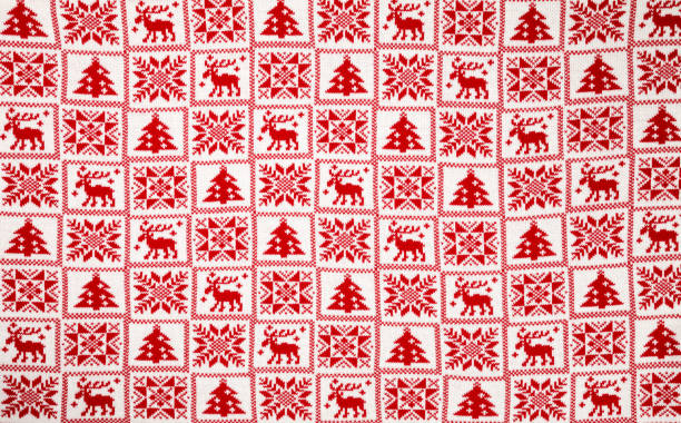 White knitted fabric with red traditional cristmas geometric ornament stock photo