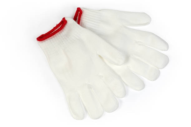 White knitted protection household gloves on a white background stock photo