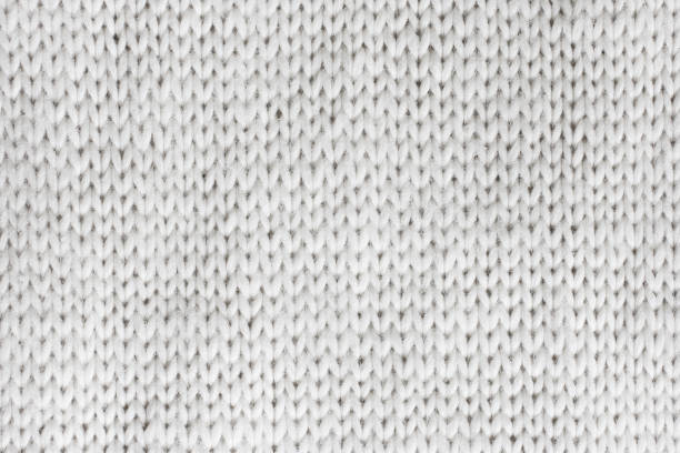 white knitted wool background. - wool stock photos and pictures