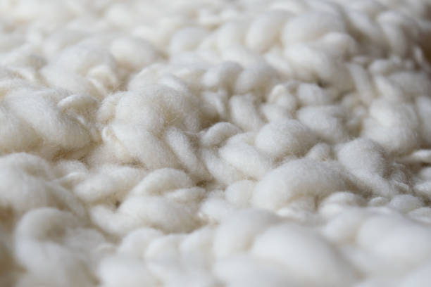white knitted woolen fabric. - wool stock photos and pictures
