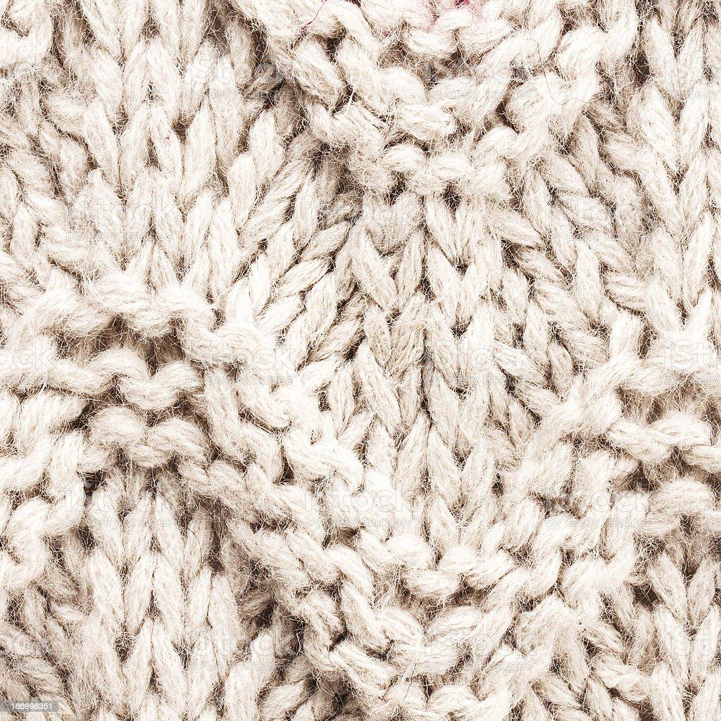 White knitting background texture. Knit woolen Fabric textile mu royalty-free stock photo
