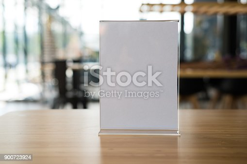 istock white label in cafe. display stand for acrylic tent card in coffee shop. mockup menu frame on table in bar restaurant. 900723924