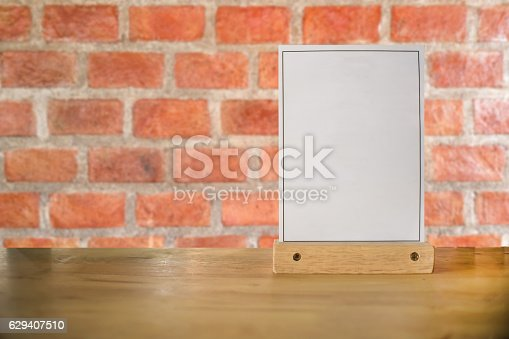 istock White label on the table. Used for menus . mockup 629407510