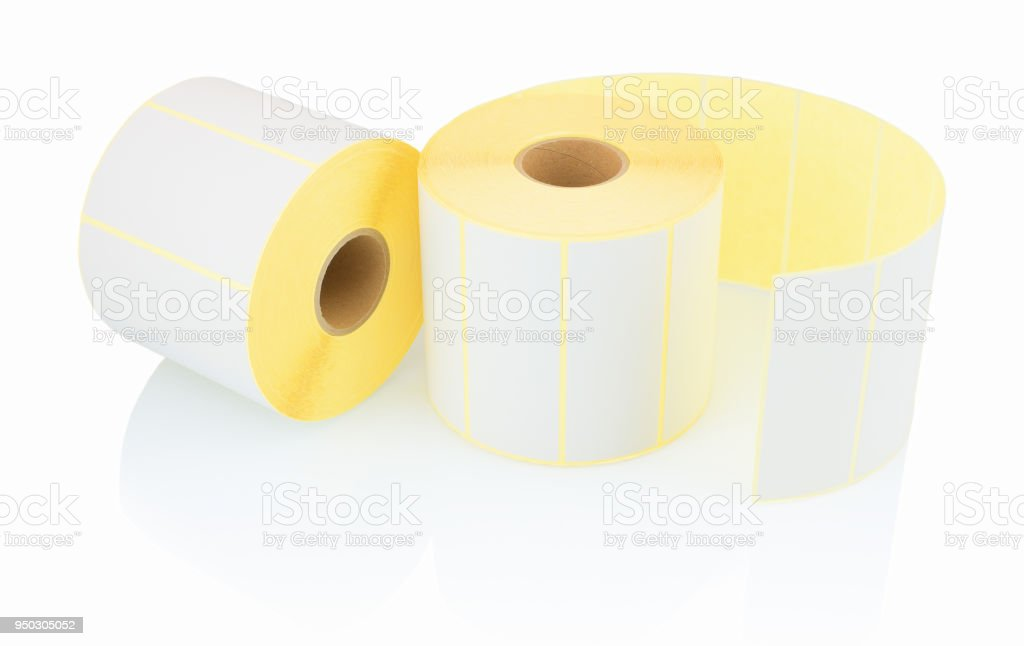 White label rolls isolated on white background with shadow reflection. White reels of labels for printers. Labels for direct thermal or thermal transfer printing. White stickers on white backdrop. stock photo