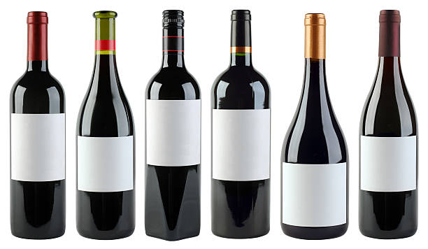 White labels on various shaped wine bottles stock photo