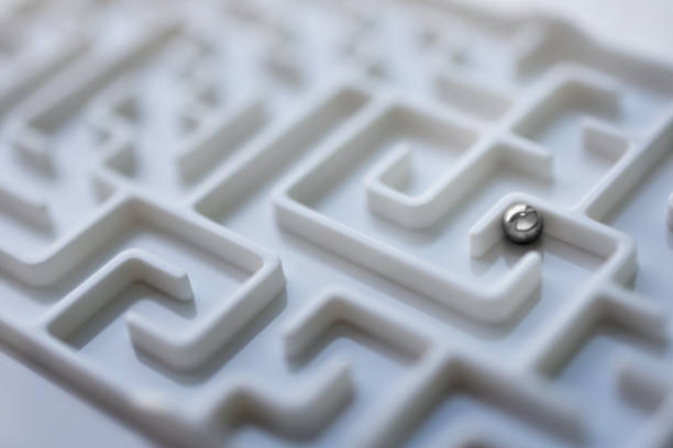 white labyrinth and metal ball, complex problem solving concept. - maze stock photos and pictures