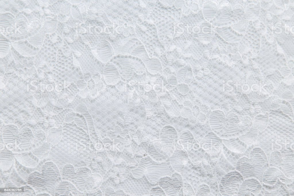 White lace with small flowers on the white background stock photo