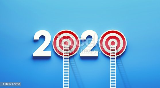 istock White Ladder Leaning on 2020  Target on Blue Wall 1160717285