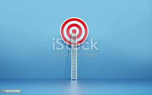 1127097479istockphoto White Ladder Leaning on A Target on Blue Wall 1160035966